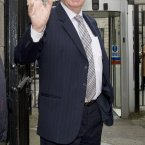 Seán Quinn waving (outside the High Court in March 2012) 