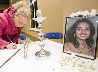 Una Jones from Celbridge signs a book of condolence for Savita Halappanavar at the CityWest Convention Centre in Dublin as part of the Diwali Festival of Lights.
