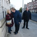 Kenny talks to a woman on his way into a cabinet meeting. Photo: Sasko Lazarov/Photocall Ireland