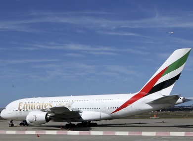 The Emirates A380 that suffered engine damage sits on the edge of the tarmac at Sydney international airport, Australia.