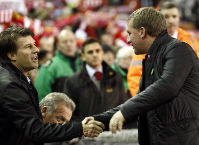 Liverpool's manager Brendan Rodgers, right, shakes hands with Swansea's manager Michael Laudrup.
