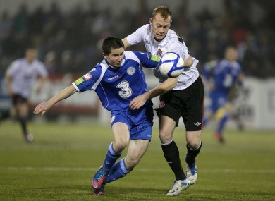 Shields battles Man of the Match Seanie Maguire during Tuesday evening's 2-2 draw at Oriel Park.