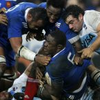 Yannick Nyanga of France, center, is tackled during this international rugby union match against Argentina at the Lille stadium, in Villeneuve d'Ascq, northern France, Sunday Nov. 17, 2012. (AP Photo/Michel Spingler)