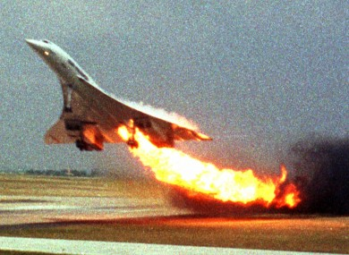 Air France Concorde flight 4590 takes off with fire trailing from its engine on the left wing from Charles de Gaulle airport in Paris