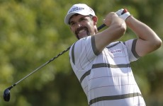 McIlroy, Donald share lead at 11 under in Dubai