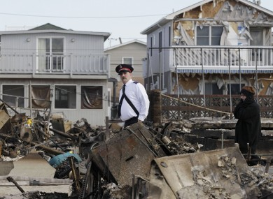 A member of the Salvation Army walks past homes in Breezy Point in New York yesterday