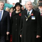 Taoiseach Enda Kenny (left) with Stormont Minister Arlene Foster and Jim Dixon (right), who was badly injured in the IRA Poppy Day bomb attack, attending a commemoration ceremony at the Enniskillen cenotaph, on the 25th anniversary of the attack.