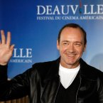 Kevin Spacey waving (at a film festival in France). 
