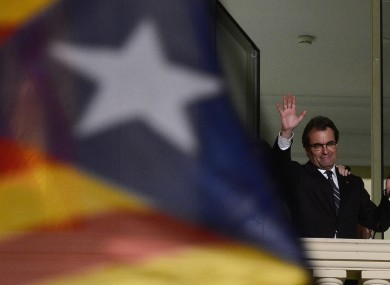 The leader of the centre-right Catalan Nationalist Coalition Artur Mas waves to crowds at a rally in Barcelona last night.