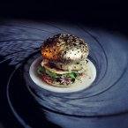 Gold tinfoil-wrapped buns, quail eggs, letuce, creme fraiche, mini-octopi.