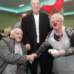 Volunteer Lorraine Egan with Archbishop of Dublin Diarmuid Martin and Denis Delaney, originally from Cork City, at the Knights of Columbanus homeless dinner in the RDS today on Christmas.