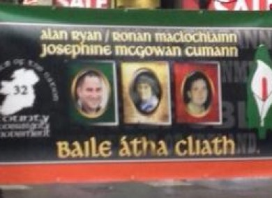 The banner featuring the face of Alan Ryan, left, on O'Connell Street today.