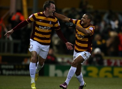 Bradford City's Garry Thompson (left) celebrates with his team-mate James Meredith.
