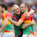 Embarcing the boss. Carlow attacker JJ Smith celebrates with his manager Luke Dempsey after Smith's late goal rescues a draw in Tullamore. (INPHO/Cathal Noonan).