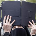 10 February: A woman uses her iPad to film a demonstration against the Syrian regime. (AP Photo/Mohammed Zaatari)