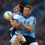 Crash, bang, wallop! Sigerson Cup winning team-mates with DCU in February, Colm Begley of Laois and Dublin's Paul Flynn are in opposition in August. (INPHO/Donall Farmer).