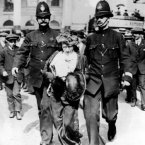 A Suffragette is led away by the Police during a London demonstration in 1912. (PA Archive)