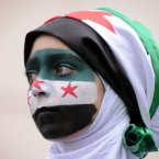 17 March: A protester takes part in a demonstration against Bashar al-Assad outside the Syrian Embassy in central London. (Dominic Lipinski/PA Archive/Press Association Images)