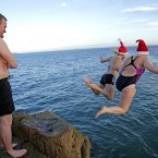 Participants in the annual Christmas Day swim at the Forty Foot  in Sandycove,Dublin.