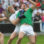 Physical struggle. Kildare's Tomas O'Connor and Stephen Lucey of Limerick in opposition in Portlaoise. (INPHO/Lorraine O'Sullivan).