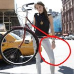 As Huffington Post put it, even if the bike is tucked behind her back, 