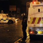 Members of the PSNI come under attack from loyalist youths in Carrickfergus.