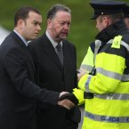 Garda Representative Association (GRA) leaders Damien McCarthy and PJ Stone shake hands with Gardai outside the home of murdered Detective Garda Adrian Donohoe at Lordship. (Image: Niall Carson/PA Wire)