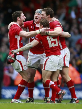 Cuthbert, Davies, North and Halfpenny celebrate beating France.