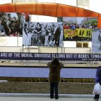 A person takes a picture of the civil rights movement float prepared for the 57th Presidential Inaugural Parade. (AP Photo/Alex Brandon)