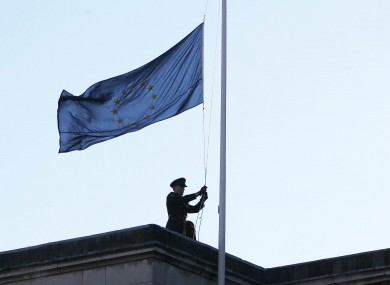 A soldier raises the EU flag over Dublin Castle