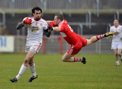 Tyrone's Joe McMahon and Derry's Paddy Bradley.