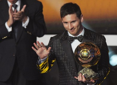 Argentina's Lionel Messi poses with the trophy after winning the FIFA Men's World Player of the Year Award.