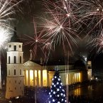 Fireworks light the sky above the Cathedral Square in Vilnius shortly after midnight, greeting the New Year. Thousands of people celebrated the beginning of the New Year 2013  in the Lithuanian capital. (AP Photo/Mindaugas Kulbis)