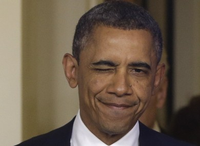 President Barack Obama winks as he arrives to make a statement regarding the passage of the fiscal cliff bill.