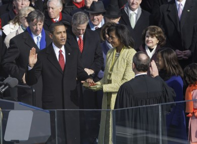 A youthful looking Barack Obama being sworn in for his first term four years ago