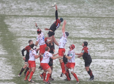 Saracens compete against Edinburgh at a snowy Vicarage Road on Sunday.