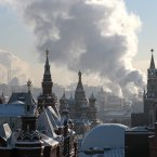 Steam from an electric power plant rises over Red Square with historical museum, left, St. Basil's cathedral, central, and Kremlin, right, in downtown Moscow, Russia, Wednesday, Jan. 23, 2013. After two weeks of snowfall Moscow enjoyed a cold sunny day. The Lenin Mausoleum, bottom center, is seen covered for reconstruction. (AP Photo/Mikhail Metzel)