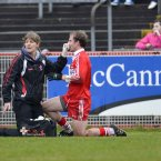 Derry's Sean Leo McGoldrick has a bloody nose looked at. Credit: Russell Pritchard / Presseye