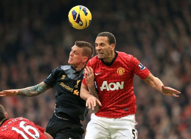 Manchester United's Rio Ferdinand (right) and Liverpool's Daniel Agger (left) battle for the ball.