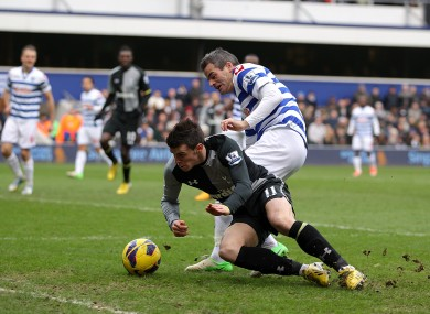 Tottenham Hotspur's Gareth Bale goes down in the area after a battle for the ball with Queens Park Rangers' Ryan Nelsen.