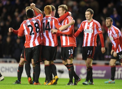 Sunderland's James McClean celebrates scoring with teammates following his goal against West Ham.