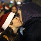 A couple kiss each other during New Year's celebrations in Madrid. (AP Photo/Andres Kudacki)