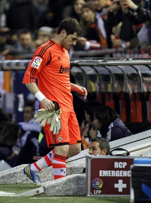 Real Madrid's goalkeeper Iker Casillas leaves the field injured during their a Copa del Rey soccer match against Valencia.