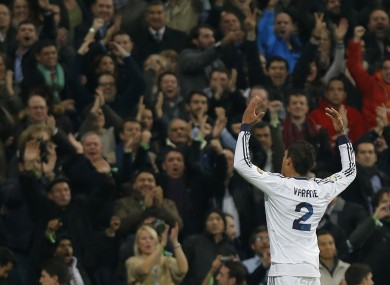 Real Madrid's Raphael Varane from France celebrates his goal during a semifinal, first leg, Copa del Rey soccer match against FC Barcelona at the Santiago Bernabeu stadium.