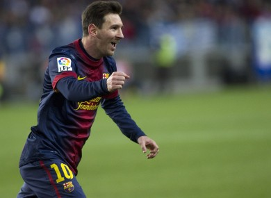 FC Barcelona's Lionel Messi from Argentina celebrates his goal during a Spanish La Liga soccer match against Malaga at the Rosaleda stadium.