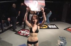 VIDEO: Inattentive round-card girl walks past unconscious fighter, doesn't realise fight is over