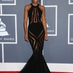 Kelly Rowland sailing dangerously close to the Grammy rules there. Also wearing black.