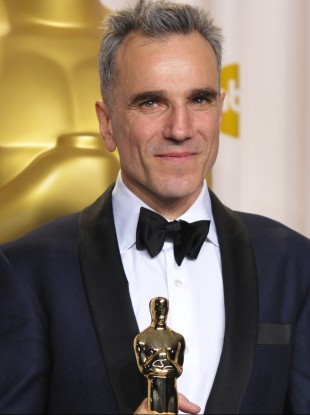 Daniel Day-Lewis poses with his award for best actor in a leading role for