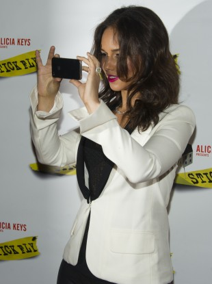 Alicia Keys, pictured using an iPhone in December 2011. Keys was appointed BlackBerry's