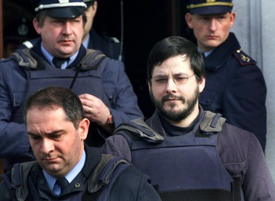 File photo from 2000 of Marc Dutroux (right) being led from a Belgian court.